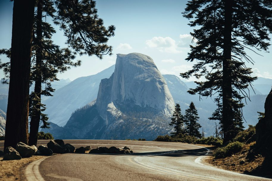 half dome viewed from a road - Trent Erwin | Unsplash